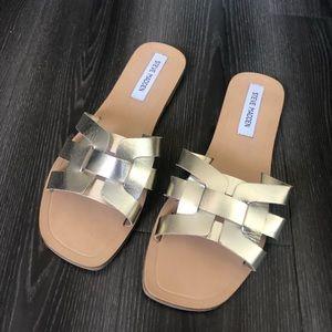 Steve Madden gold leather slide sandals.